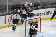 Colorado Avalanche center Tyson Jost (17) celebrates his goal with teammates during the second period of an NHL hockey game against the Los Angeles Kings Friday, May 7, 2021, in Los Angeles. (AP Photo/Marcio Jose Sanchez)