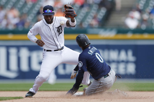 Detroit Tigers shortstop Niko Goodrum misplays the throw from catcher John Hicks to allow Seattle Mariners' Mallex Smith to safely steal second base during the seventh inning of a baseball game, Thursday, Aug. 15, 2019, in Detroit. (AP Photo/Carlos Osorio)