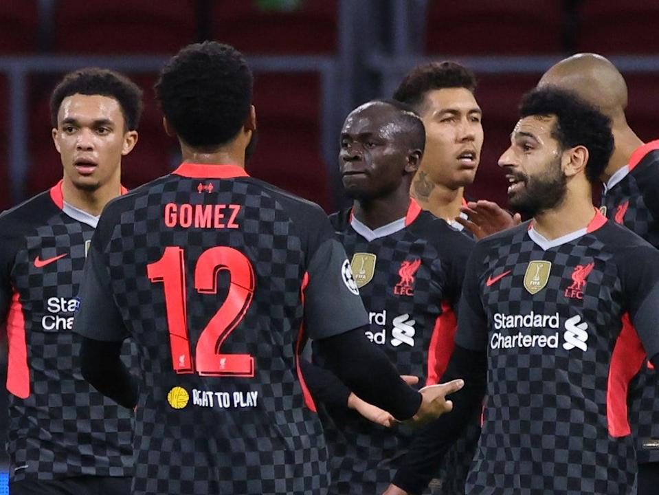 Liverpool players celebrate after Ajax scored an own goal (AFP)