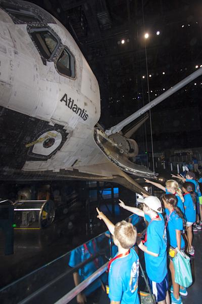 At the Kennedy Space Center Visitor Complex in Florida, Camp Kennedy Space Center participants get an up-close look at the space shuttle Atlantis during a weeklong summer activity for students entering second through ninth grades. Their tour to