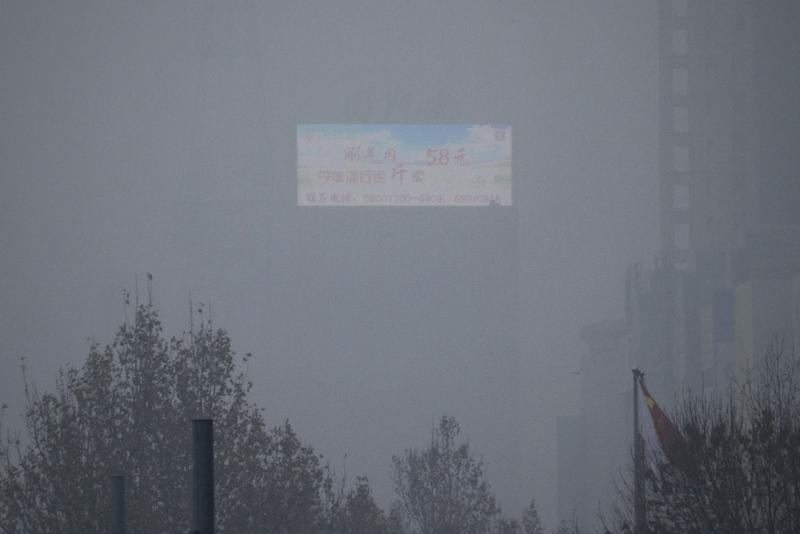 Toxic smog in China has caused schools, factories, construction sites, roads and airports to close (AFP Photo/WANG ZHAO)