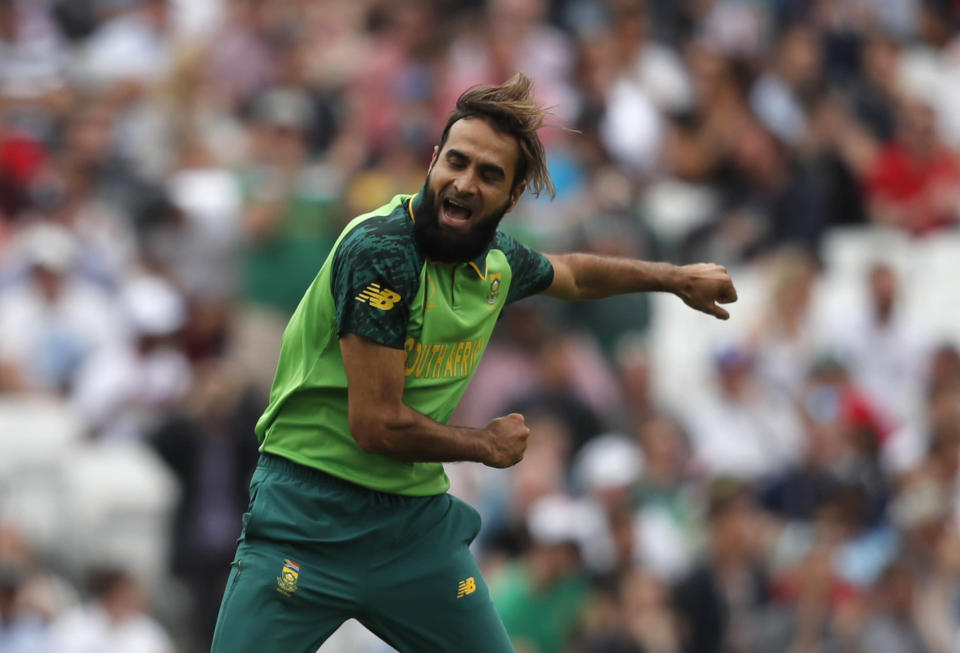 South Africa's Imran Tahir celebrates after taking the wicket of England's captain Eoin Morgan caught by South Africa's Aiden Markram during their Cricket World Cup match at the Oval in London, Thursday, May 30, 2019. (AP Photo/Frank Augstein)