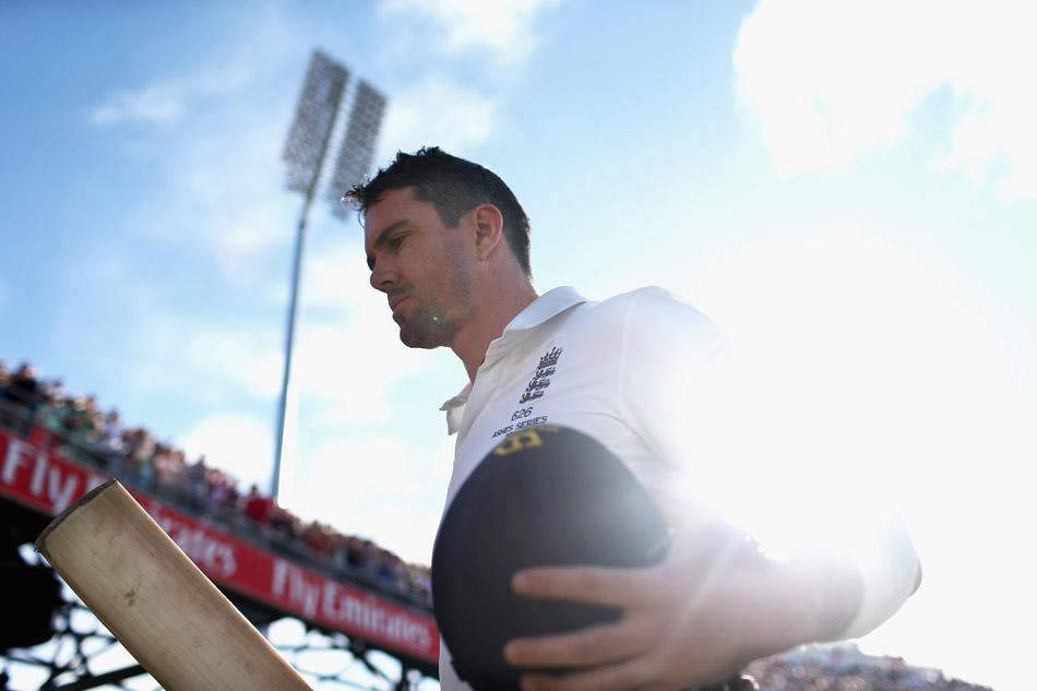 MANCHESTER, ENGLAND - AUGUST 03:  Kevin Pietersen of England raises his bat after he was dismissed for 113 runs by Mitchell Starc of Australia  during day three of the 3rd Investec Ashes Test match between England and Australia at Emirates Old Trafford Cricket Ground on August 3, 2013 in Manchester, England.  (Photo by Ryan Pierse/Getty Images)