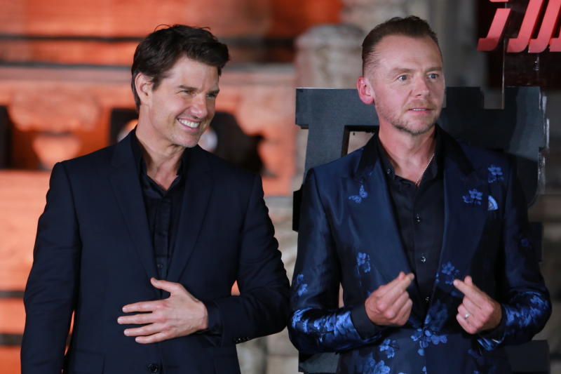 BEIJING, CHINA - AUGUST 29: Actor Tom Cruise (L) and actor Simon Pegg attend 'Mission: Impossible - Fallout' press conference at the Imperial Ancestral Temple on August 29, 2018 in Beijing, China. (Photo by Visual China Group via Getty Images)