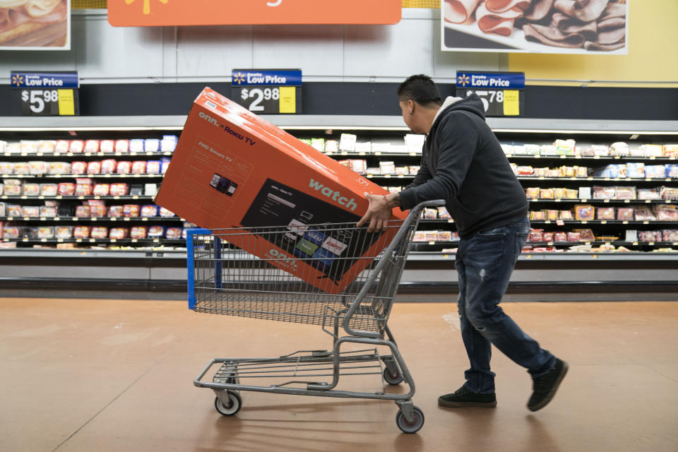 KING OF PRUSSIA, PA - NOVEMBER 28: A man shops for a television in Walmart on Thanksgiving night ahead of Black Friday on November 28, 2019 in King of Prussia, United States. (Photo by Sarah Silbiger/Getty Images)