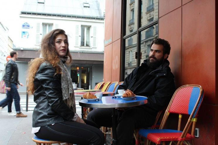 Siblings Mohammad and Anmar Hijazi at a cafe on Paris on the morning of the French presidential election. (Photo by Shawn Carrié)