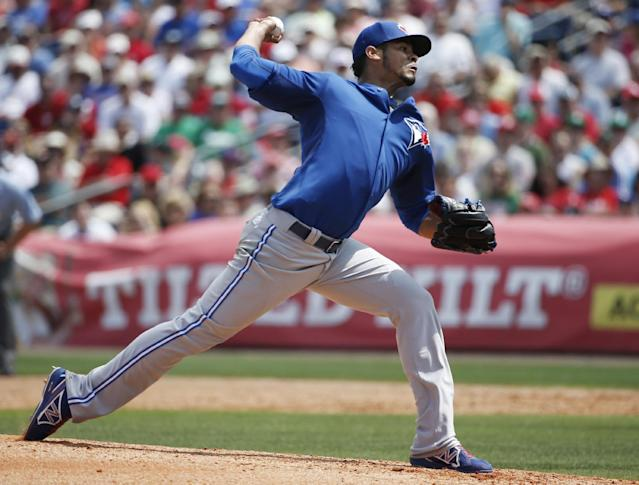 Toronto Blue Jays starting pitcher Esmil Rogers delivers in the second inning of a spring exhibition baseball game against the Philadelphia Phillies in Clearwater, Fla., Thursday, March 20, 2014. The Blue Jays won 3-1. (AP Photo/Kathy Willens)