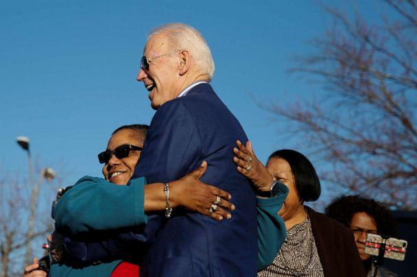 PHOTO: Democratic presidential candidate and former U.S. Vice President Joe Biden receives a hug from a supporter outside a polling site, in Greenville, S.C. on Feb. 29, 2020. (Elizabeth Frantz/Reuters)
