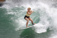 Surfer Tatiana Weston-Webb of the United States works out on a Surf Ranch wave during practice rounds for the upcoming Olympics Wednesday, June 16, 2021, in Lemoore, Calif. The Summer Games in Tokyo, which kick off this month, serve as a proxy for that unresolved tension and resentment, according to the Native Hawaiians who lament that surfing and their identity have been culturally appropriated by white outsiders who now stand to benefit the most from the $10 billion industry.(AP Photo/Gary Kazanjian)