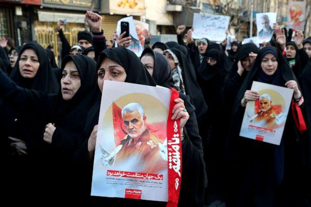 PHOTO: Demonstrators chant slogans while holding up posters of Gen. Qassem Soleimani during a protest in front of the British Embassy in Tehran, Iran, Jan. 12, 2020. (Ebrahim Noroozi/AP)
