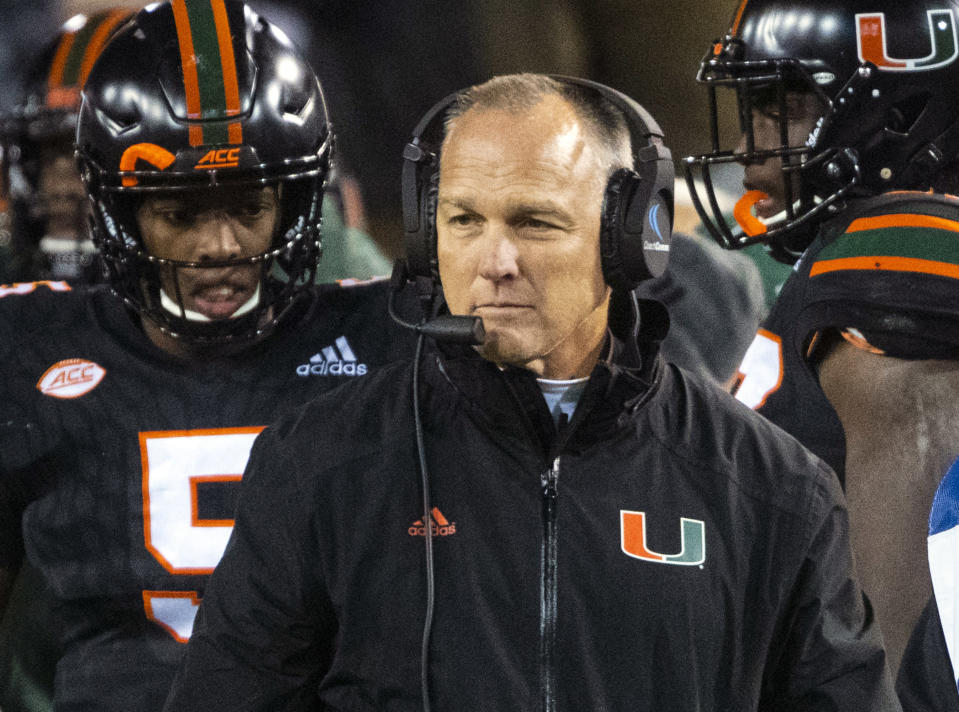 FILE - In this Nov. 10, 2018, file photo, Miami coach Mark Richt walks the sideline during the second half of an NCAA college football game against Georgia Tech in Atlanta. Richt has made the stunning decision to retire, leaving after three years leading his alma mater and with five years remaining on his contract. Richt says the decision was his and came in the best interests of the program. (AP Photo/John Amis, File)