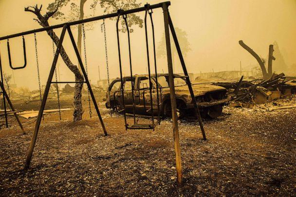 PHOTO: TOPSHOT - A charred swing set and car are seen after the passage of the Santiam Fire in Gates, Oregon, on September 10, 2020. (Kathryn Elsesser/AFP via Getty Images)