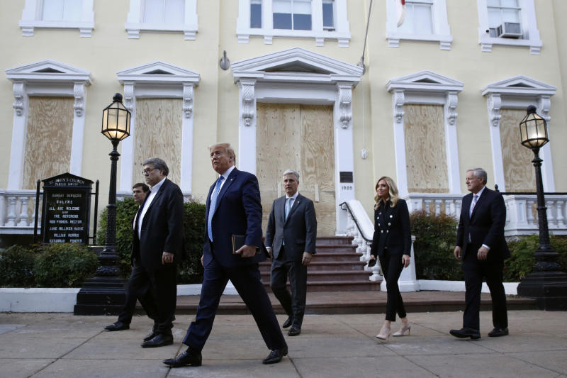 President Donald Trump departs after visiting outside St. John's Church across Lafayette Park from the White House Monday, June 1, 2020, in Washington. Part of the church was set on fire during protests on Sunday night. Walking with Trump are Defense Secretary Mark Esper, from left, Attorney General William Barr, White House national security adviser Robert O'Brien, White House press secretary Kayleigh McEnany and White House chief of staff Mark Meadows. (AP Photo/Patrick Semansky)