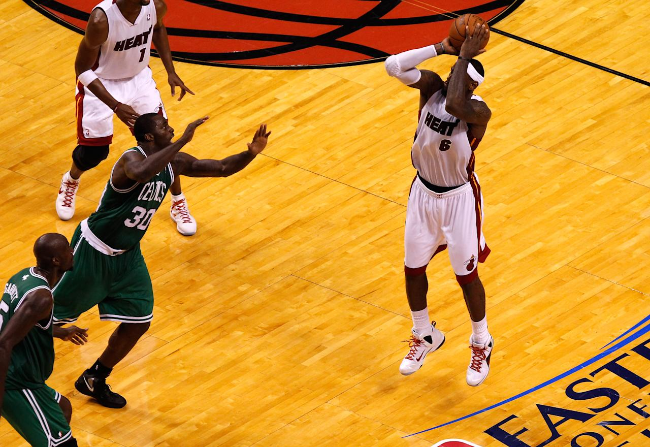 MIAMI, FL - JUNE 09:  LeBron James #6 of the Miami Heat makes a deep three-pointer in the fourth quarter against the Boston Celtics in Game Seven of the Eastern Conference Finals in the 2012 NBA Playoffs on June 9, 2012 at American Airlines Arena in Miami, Florida. NOTE TO USER: User expressly acknowledges and agrees that, by downloading and or using this photograph, User is consenting to the terms and conditions of the Getty Images License Agreement.  (Photo by J. Meric/Getty Images)