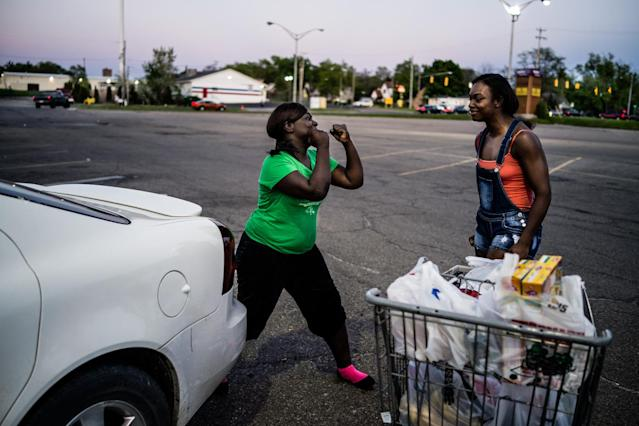 "<p>Olympic Gold Medal Boxer Claressa ""T-Rex"" Shields (R) and her sister Brianna (17 years old) play fight in a supermarket parking lot in Flint, Michigan. May 2014. (Photograph by Zackary Canepari) </p>"