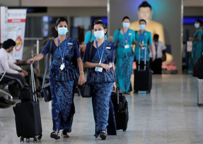 Sri Lankan Airlines staff wear masks at Bandaranaike International Airport after Sri Lanka confirmed the first case of coronavirus in the country, in Katunayake