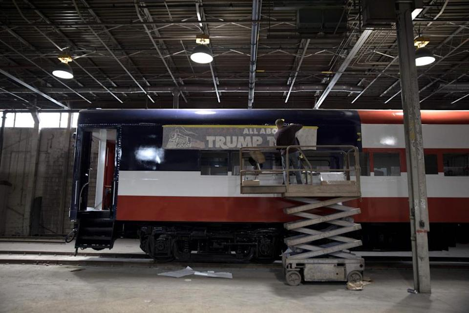 A worker refurbishes a passenger train car named the Trump Train. inLordstown on 15 October.