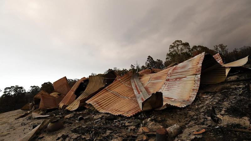 Weather conditions have eased but authorities warn the bushfire threat remains active