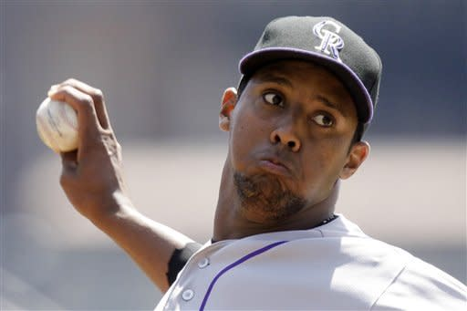 Colorado Rockies pitcher Juan Nicasio throws in the first inning of a baseball game against the Pittsburgh Pirates in Pittsburgh Wednesday, April 25, 2012. (AP Photo/Gene J. Puskar)