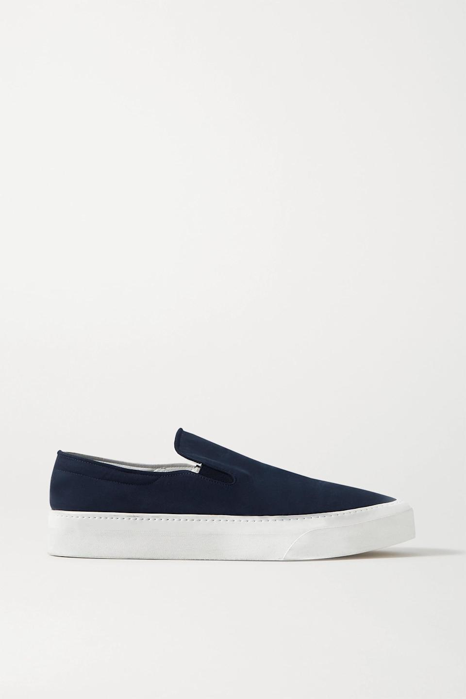 <p><span>The Row Navy Marie H Canvas Slip-On Sneakers</span> ($760)</p>