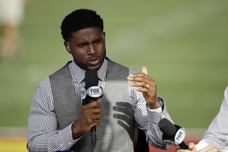 Former Southern California player Reggie Bush rehearses for a pregame show, at an NCAA college football game between Southern California and Utah on Friday, Sept. 20, 2019, in Los Angeles. (AP Photo/Marcio Jose Sanchez)