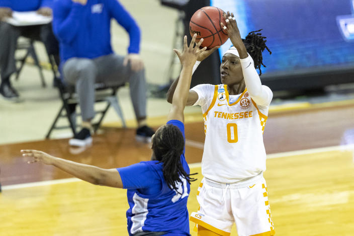 Tennessee guard Rennia Davis, right, looks to shoot over Middle Tennessee State guard Deja Cage during the first half of a college basketball game in the first round of the women's NCAA basketball tournament at the Frank Erwin Center in Austin, Texas, Sunday, March 21, 2021. (AP Photo/Stephen Spillman)