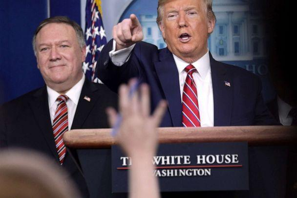 PHOTO: President Donald Trump takes questions as Secretary of State Mike Pompeo looks on during a news briefing at the White House,  March 20, 2020. (Alex Wong/Getty Images, FILE)