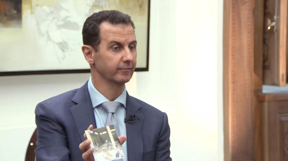 Syrian President Bashar Assad speaks about torture photos during an interview with Yahoo News. (Yahoo News Video)