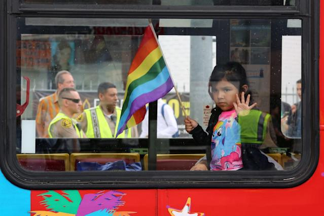 <p>Los Angeles County Sheriff's deputies are seen behind a girl riding in a bus at the 46th annual Los Angeles Gay Pride Parade in West Hollywood, Calif., after a gunman opened fire at a gay nightclub in Orlando, Fla., June 12, 2016. (David McNew/Reuters) </p>