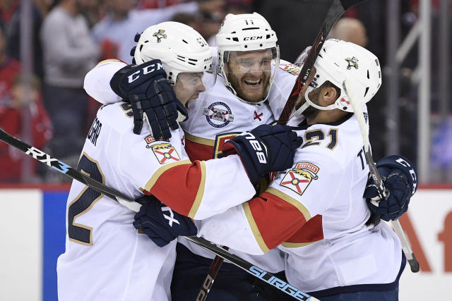 Florida Panthers left wing Jonathan Huberdeau (11) celebrates with defenseman MacKenzie Weegar, left, and center Vincent Trocheck, right, after an NHL hockey game against the Washington Capitals, Friday, Oct. 19, 2018, in Washington. Huberdeau scored the deciding shootout goal. The Panthers won 6-5 in a shootout. (AP Photo/Nick Wass)