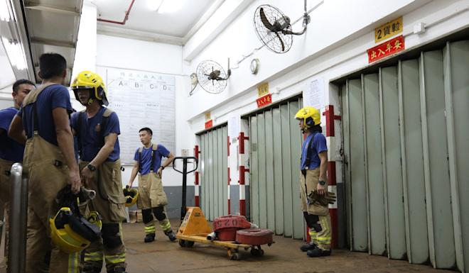 Firefighters on standby at the industrial building. Photo: Felix Wong