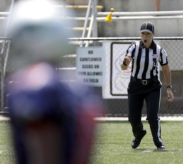 IMAGE DISTRIBUTED FOR NATIONAL FOOTBALL LEAGUE - Line judge Catherine Conti tosses a flag at the Women's Football East West All-Star Championships, on Saturday, July 26, 2014 at District Three Stadium in Rock Hill, S.C. (Bob Leverone/AP Images for the National Football League)