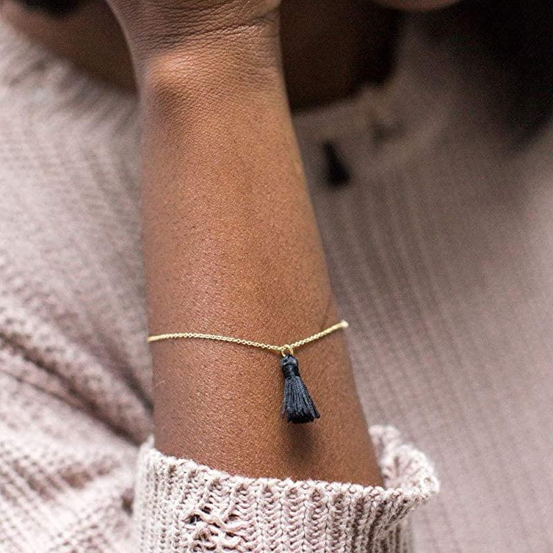<p>Add a whimiscal touch to their wrist with this <span>Dainty Tassel Bracelet - Navy, Dark Blue</span> ($28). It can be worn day and night.</p>
