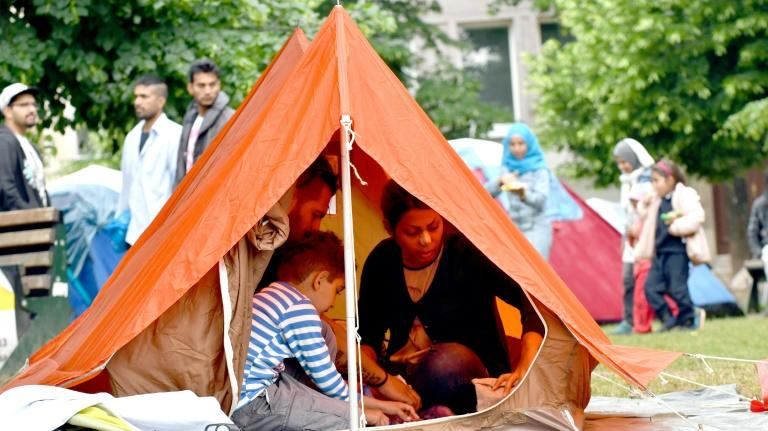 Migrant family with children rest inside their tent in a park in Sarajevo, on May 14, 2018. Migrants are carving a new Balkan route through Bosnia to reach the European Union raising fears of a humanitarian and security crisis in the poor country