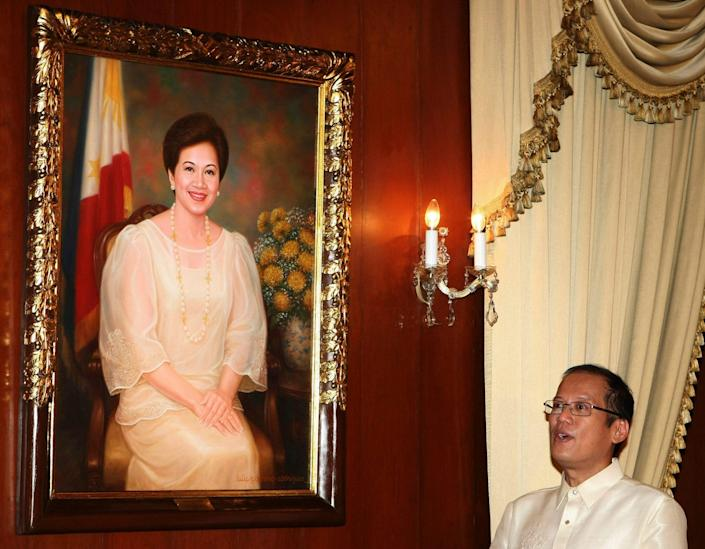 Aquino with a portrait of his mother Corazon, the Philippines' first leader following the end of the Marcos regime - Rolex dela Pena/AP