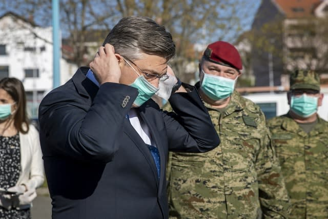 Croatia's Prime Minister Andrej Plenkovic said the country was dealing with two crises. (Darko Bandic/AP)