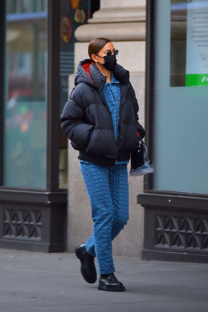 <p>The supermodel wore a MOSCHINO X PALACE puffer jacket with matching Moschino denim and chunky lace-ups for the school run in New York. </p>