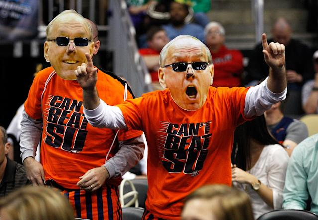 Fans of the Syracuse Orange wear giant masks with the likeness of Syracuse head coach Jim Boeheim against the Kansas State Wildcats during the third round of the 2012 NCAA Men's Basketball Tournament at Consol Energy Center on March 17, 2012 in Pittsburgh, Pennsylvania. (Photo by Jared Wickerham/Getty Images)
