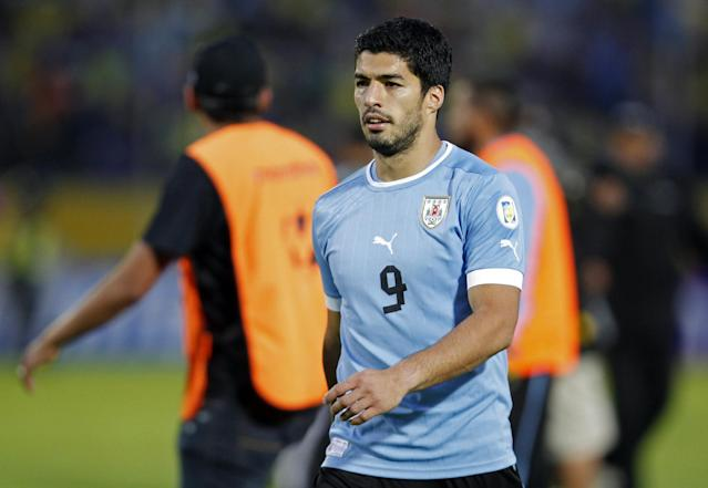 FILE - In this Friday, Oct. 11, 2013 file photo, Uruguay's Luis Suarez walks off the pitch at the end of a 2014 World Cup qualifying soccer game against Ecuador in Quito, Ecuador. Uruguay striker Luis Suarez has undergone keyhole surgery on his knee and is expected to recover in time for the World Cup. The mother of the 27-year-old Liverpool striker says he had surgery Thursday to repair damage to his meniscus. Sandra Diaz tells The Associated Press that the surgery was successful and that he is expected to recover in 2-3 weeks. Uruguay plays its first match at the World Cup against Costa Rica on June 14. The team will then face England on June 19 and Italy on June 24. (AP Photo/Martin Mejia, file)