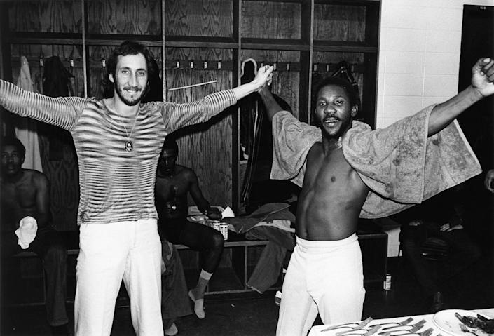 <p>Peter Townshend of The Who and Toots Hibbert of Toots & the Maytals strike the same pose, while waiting backstage at a festival in Providence, Rhode Island. </p>
