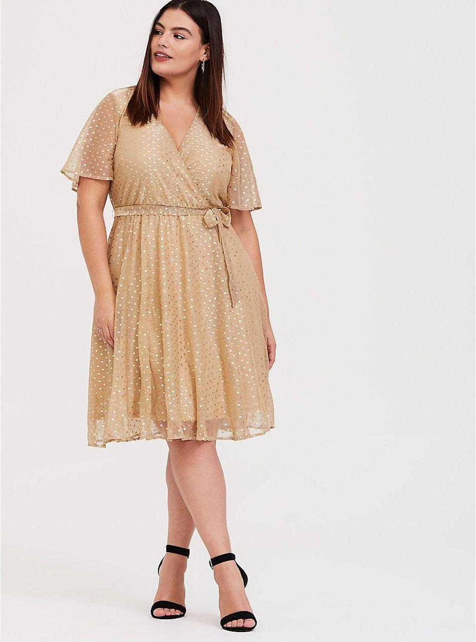 "<p>torrid.com</p><p><strong>$51.67</strong></p><p><a href=""https://go.redirectingat.com?id=74968X1596630&url=https%3A%2F%2Fwww.torrid.com%2Fproduct%2Fgold-metallic-polka-dot-mesh-wrap-dress%2F12141767.html&sref=https%3A%2F%2Fwww.goodhousekeeping.com%2Fholidays%2Fg29954145%2Fplus-size-new-years-dresses%2F"" rel=""nofollow noopener"" target=""_blank"" data-ylk=""slk:Shop Now"" class=""link rapid-noclick-resp"">Shop Now</a></p><p>A basic wrap dress gets a sweet upgrade for New Year's Eve with a mesh overlay covered in metallic gold polka dots. </p>"