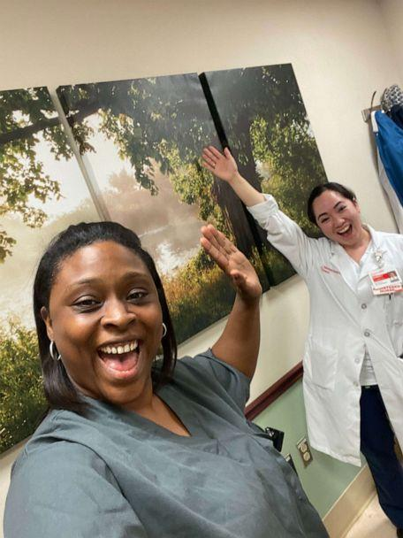 PHOTO: Dawn Jones and Kym Villamer, two health care workers at New York Presbyterian Queens, pose for a photo amid their day singing to patients and hospital staff. (Kym Villamer)