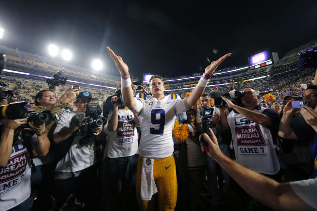 FILE - In this Nov. 30, 2019, file photo, LSU quarterback Joe Burrow (9) gestures thanks to the student section after playing his last game in Tiger Stadium, an NCAA college football game against Texas A&M, in Baton Rouge, La. Heading into this years slate of conference title games a case could be made that No. 1 LSU (No. 2 CFP), No. 2 Ohio State (No. 1 CFP) and No. 3 Clemson (No. 3 CFP) have all done enough already to lose their conference championship games and still get in the College Football Playoff. (AP Photo/Gerald Herbert, File)