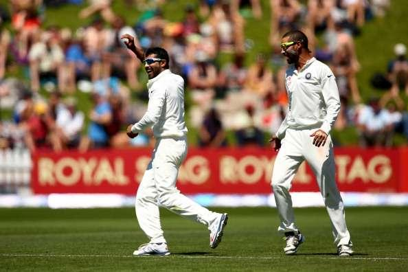 WELLINGTON, NEW ZEALAND - FEBRUARY 16: Ravindra Jadeja of India (L) celebrates his wicket of Corey Anderson of New Zealand with Shikhar Dhawan (R) during day three of the 2nd Test match between New Zealand and India at the Basin Reserve on February 16, 2014 in Wellington, New Zealand. (Photo by Phil Walter/Getty Images)