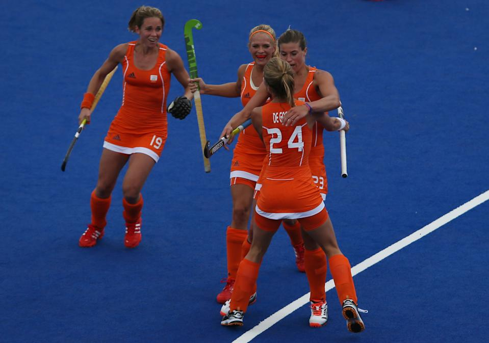 LONDON, ENGLAND - JULY 29: Kim Lammers of the Netherlands celebrates scoring the opening goal with her team mates during the Women's Pool WA Match W02 between the Netherlands and Belgium at the Hockey Centre on July 29, 2012 in London, England. (Photo by Daniel Berehulak/Getty Images)