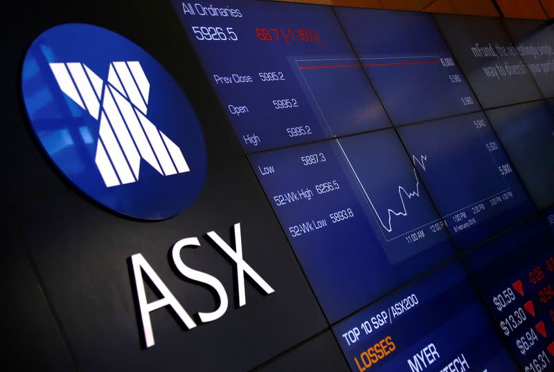 A board displaying stock prices is seen at the Australian Securities Exchange in Sydney