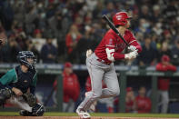 Los Angeles Angels' Shohei Ohtani flies out during the first inning of a baseball game against the Seattle Mariners, Friday, Oct. 1, 2021, in Seattle. (AP Photo/Ted S. Warren)