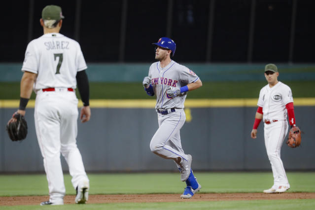 New York Mets' Jeff McNeil runs the bases after hitting a solo home run off Cincinnati Reds starting pitcher Luis Castillo in the sixth inning of a baseball game Friday, Sept. 20, 2019, in Cincinnati. (AP Photo/John Minchillo)