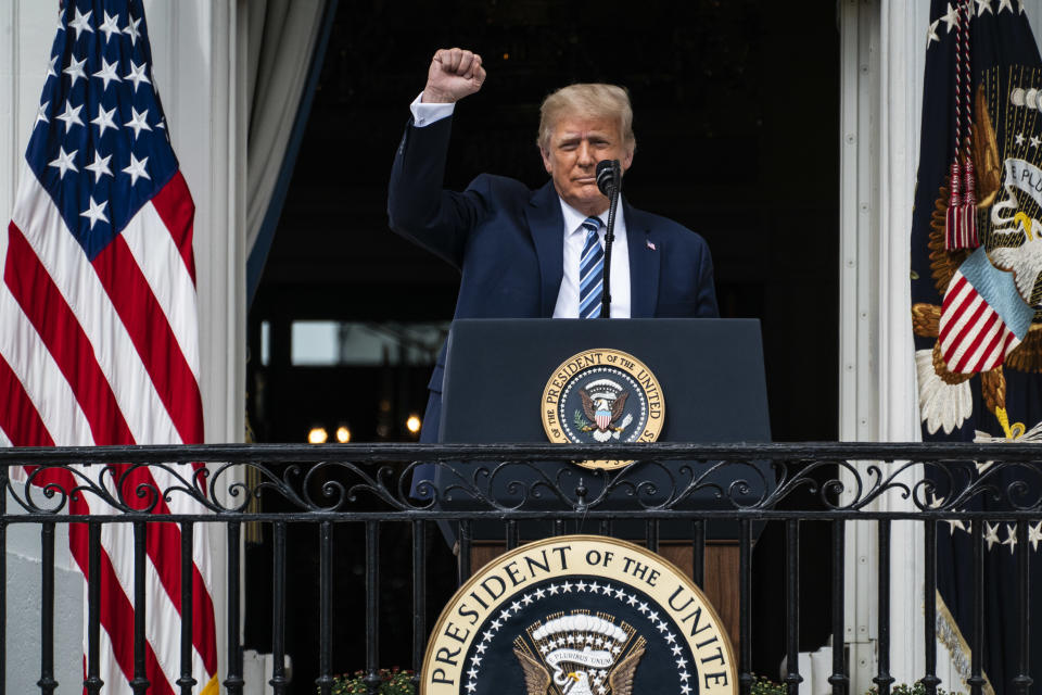 WASHINGTON, DC - OCTOBER 10: President Donald J. Trump speaks to supporters from the Blue Room balcony during an event at the White House on Saturday, Oct 10, 2020 in Washington, DC. President Donald J. Trump remains at the White House after testing positive for covid-19. (Photo by Jabin Botsford/The Washington Post via Getty Images)