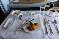 <p>I was quickly handed my menu. Let's just say for a three-hour flight, it was complete overkill. Since I was starting to feel hungry again, I ordered the Spanish omelette with fruit as a starter. The flight attendant set up my seat into a mini-dining area, complete with table cloth and fine china. The first thing that struck me was how beautiful the plating was, even if it was just fruit. The fruit was very fresh and it whet my appetite for the omelet. The Spanish omelet was amazing, it was almost like you headed to some hip brunch place and ordered one fresh off the stove. <i>(Photo: Sam Huang)</i><br></p>